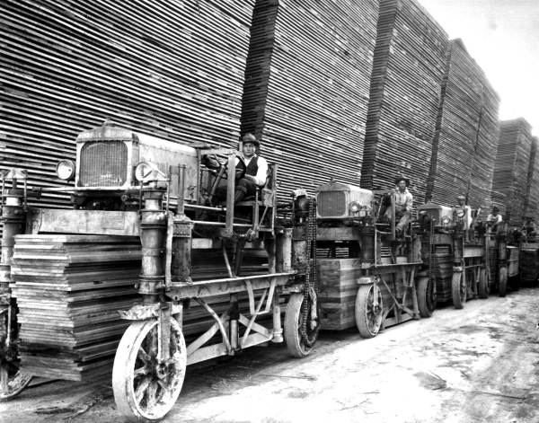 Hauling lumber with straddle carriers at Putnam Lumber Company - Shamrock, Florida. 1929. Black & white photoprint, 8 x 10 in. State Archives of Florida, Florida Memory. <https://www.floridamemory.com/items/show/24975>, accessed 12 January 2018.